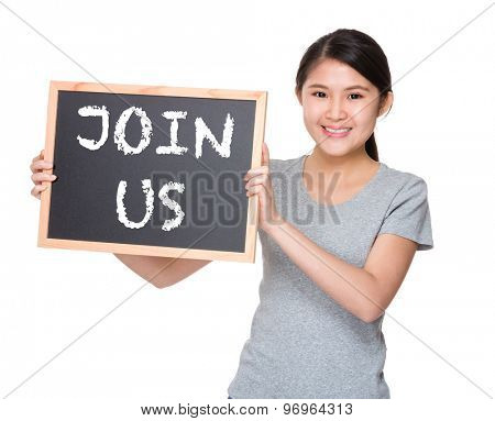 Young student hold with black board showing phrase join us
