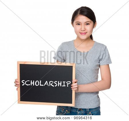 Young woman with the blackboard and showing a word scholarship