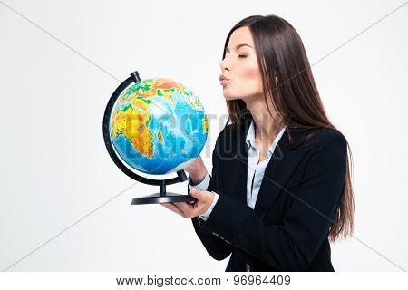 Businesswoman blowing on globe isolated on a white background