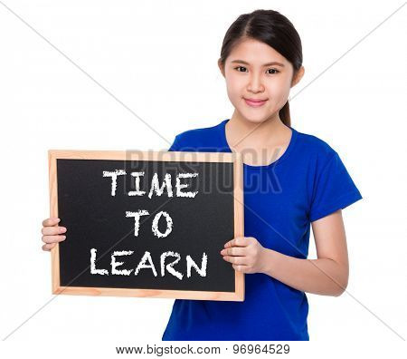 Asian student show with blackboard phrase time to learn