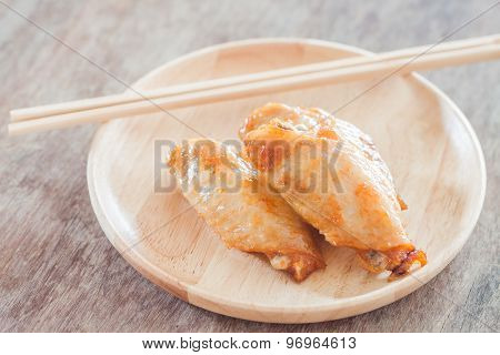 Grilled Chicken Wings On Wooden Plate