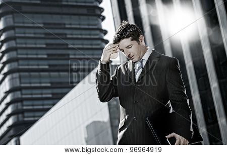 Businessman Standing Outdoors On Street At Financial District Suffering Headache