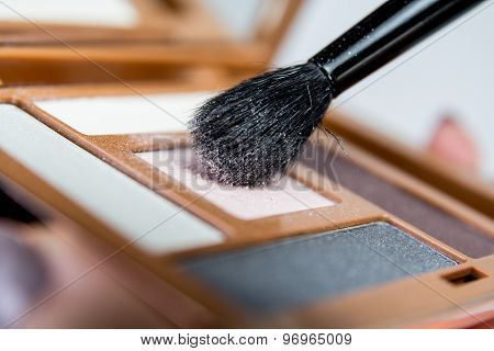 Eye shadow palette with make up brush