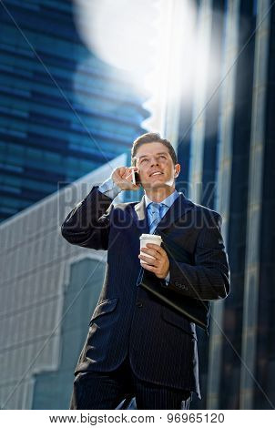 Young Attractive Businessman In Suit And Tie Talking On Mobile Phone Oudoors