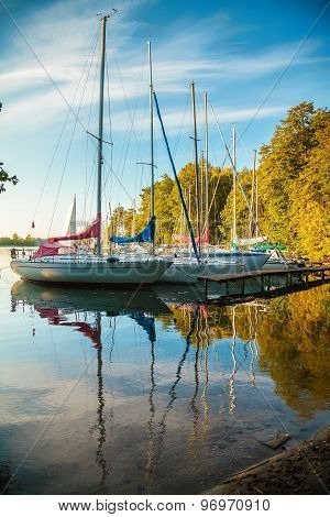 Yachts Standing On The Dock At The Lake Galve In Trakai