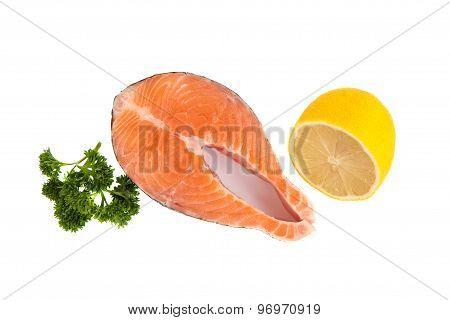Isolated Salmon Steak, Parsley And Lemon
