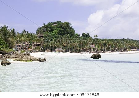Tropical beach with coconut palm tree white sand and turquoise sea water Philippines Boracay
