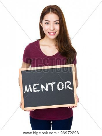 Young woman show with chalkboard a word mentor