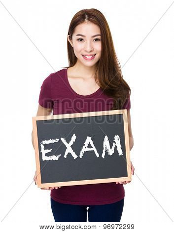 Young woman show with chalkboard a word exam