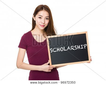 Young woman with blackboard showing a word scholarship