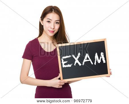 Young woman with blackboard showing a word exam