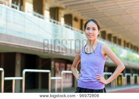 Asian woman with tracksuit in sport stadium
