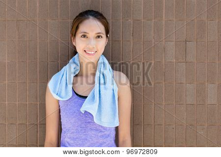 Young woman with red brick wall