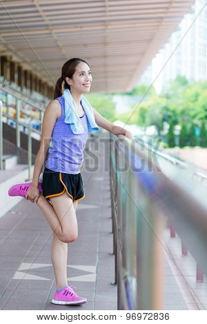 Woman doing stretching and in sport arena