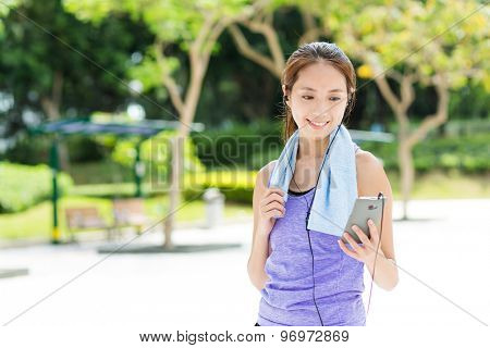 Sporty girl listen to music after running