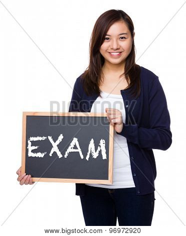 Woman showing the chalkboard with a word exam