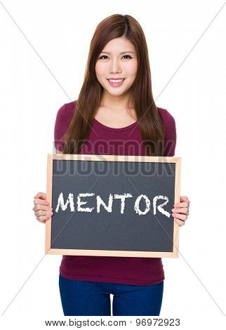 Woman hold with blackboard showing a word mentor