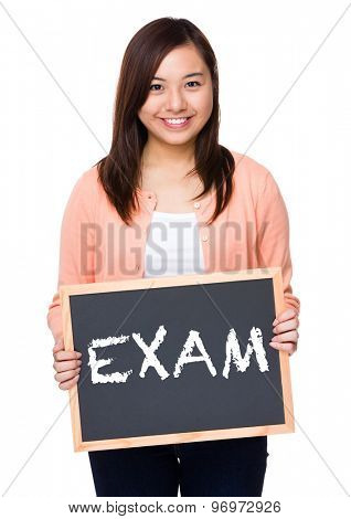 Asian woman with black board showing a word exam