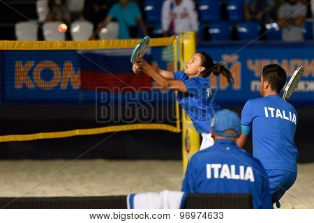 MOSCOW, RUSSIA - JULY 19, 2015: Marco Garavini (right) and Federica Bacchetta of Italy in the final match of the Beach Tennis World Team Championship against Russia. Italy become world champion