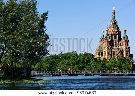 PETERHOF, ST. PETERSBURG, RUSSIA - JUNE 7, 2015: Saints Peter and Paul Cathedral viewed from Olga's pond. Built in 1905 by design of N. Sultanov, it is a superb example of Russian Revival architecture