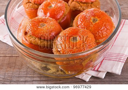 Stuffed tomatoes on a glass bowl.
