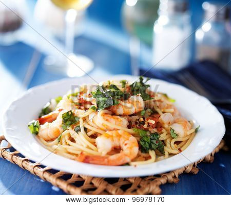 shrimp spaghetti pasta with fresh basil and crushed red pepper