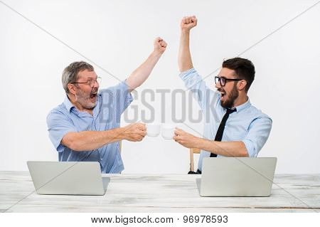 The two colleagues working together at office on white background
