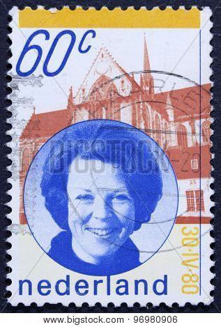 Former queen on an postage stamp.