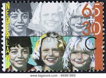 Children on a postage stamp.