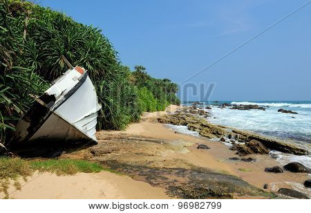 Old Yacht Stranded On A Beach