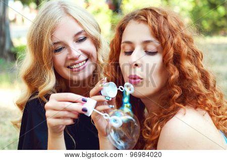Two Friends Blowing Soap Bubbles