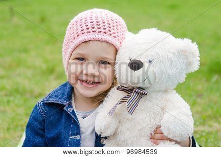 Girl Hugging A Teddy Bear Picnic