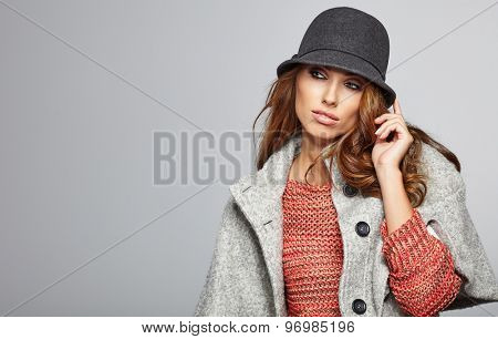 Amazing beautiful  brunette woman in autumn color. Studio shoot