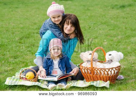 Mother And Two Daughters On A Picnic