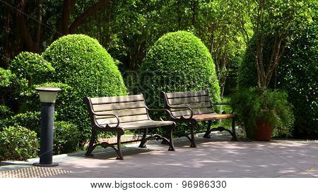 Outdoor benches in formal garden