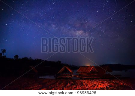 Silhouette Of Floating House And Milky Way. Long Exposure Photograph.