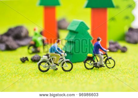 Image Group Of People(mini Figure) With Retro Bicycle In A Park - Outdoor Portrait