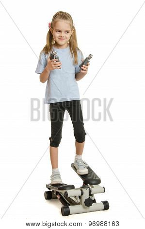 Six Year Old Girl On A Step Simulator With Expander In The Hands Of