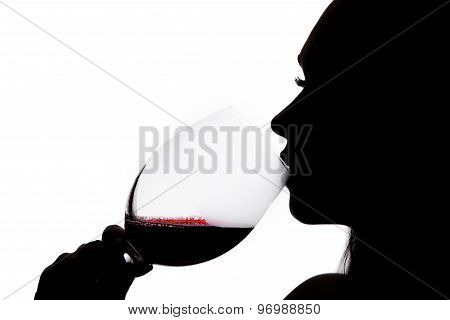 Silhouette Of A Drinking Woman