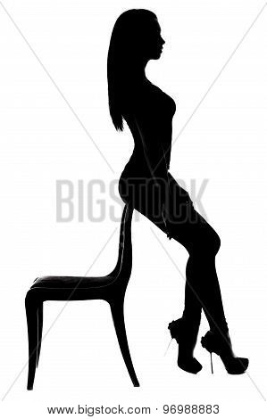 Silhouette Of A Woman Sitting On The Chair