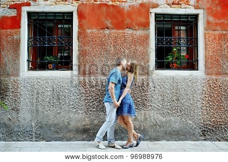 Romantic Couple Kissing In Venice, Italy