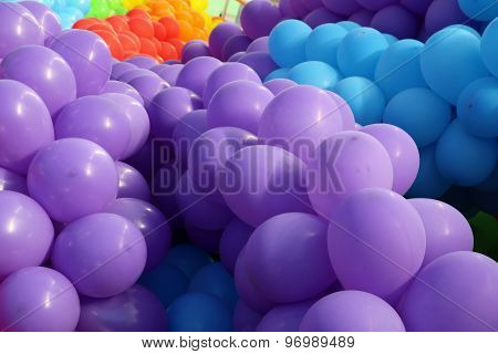 Violet balloons looks as grapes