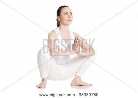 Female Sitting In Yoga Squat