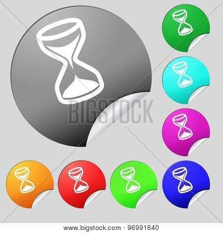Hourglass Icon Sign. Set Of Eight Multi Colored Round Buttons, Stickers. Vector