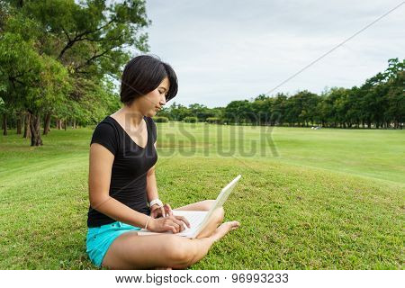 Asian Girl Look At Her Laptop