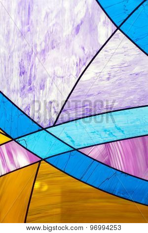 Colourful glass: orange, blue, aqua, purple pattern