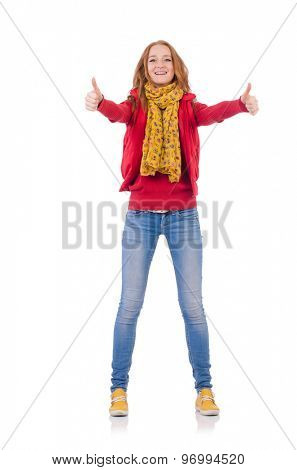 Cute smiling girl in red jacket and jeans isolated on white