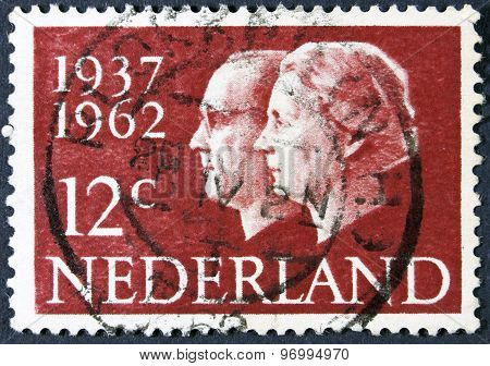 Former queen and prince on a postage stamp.