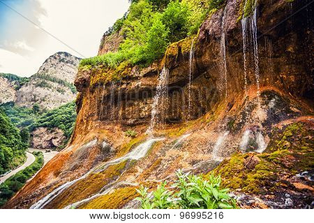 top tier of Chegem waterfalls in canyon