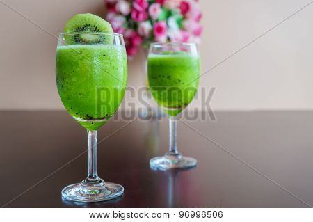 Fresh Green Kiwi Juice On Wooden Table
